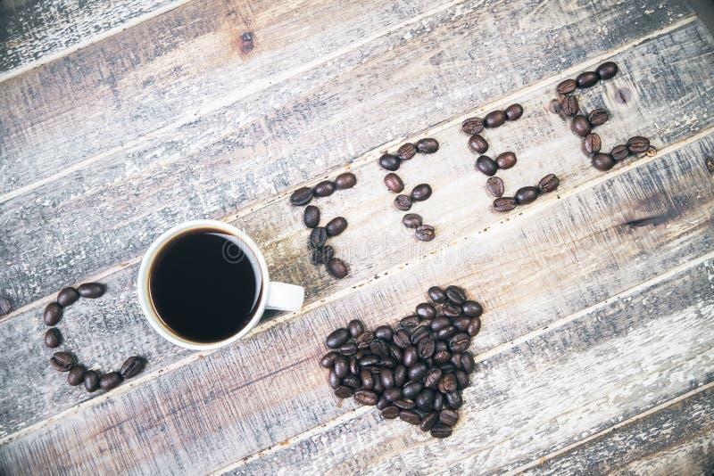 Caffè su legno antico fotografia stock libera da diritti