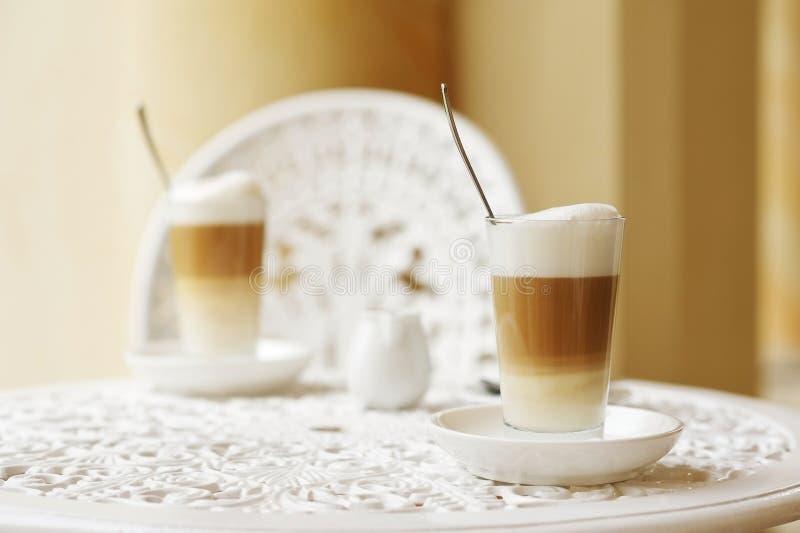Caffe Latte Macchiato. Two Cups of Caffe Latte Macchiato on a Table stock photo