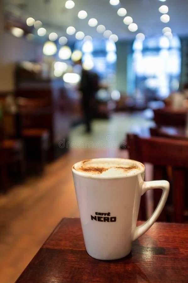 Caffe Nero (cappuccino) royaltyfria bilder