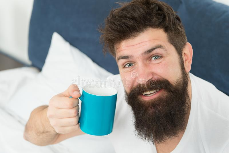 Caffeine addicted. Coffee fills you with energy. Good gay begins from cup of coffee. Coffee affects body. Man handsome stock photo