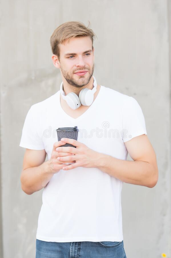Daily caffeine amount. What type of coffee is most popular. Handsome man drink coffee to go paper cup. Cafe concept. Coffee shop. Peaceful calm guy enjoy fresh stock photo