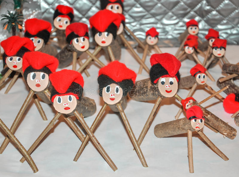 Caga tio (Tio de Nadal) for sale on counter of Christmas market. royalty free stock photography