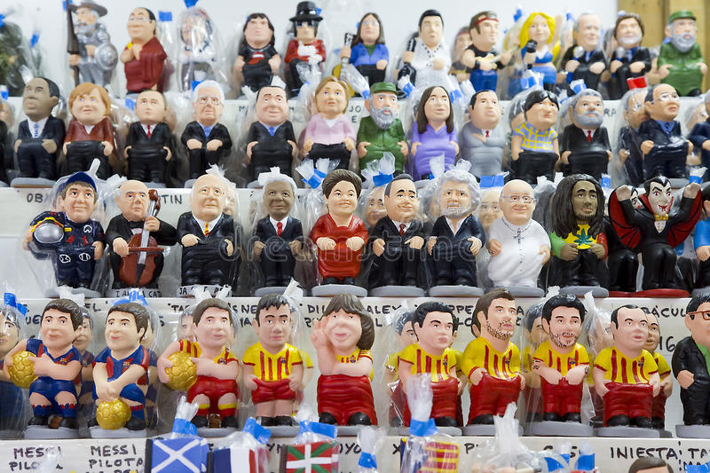 Caganers in Santa Llucia fair, Barcelona. BARCELONA - DECEMBER 1: Caganers, originally a character in Catalan mythology, now portraying famous celebrities or royalty free stock images