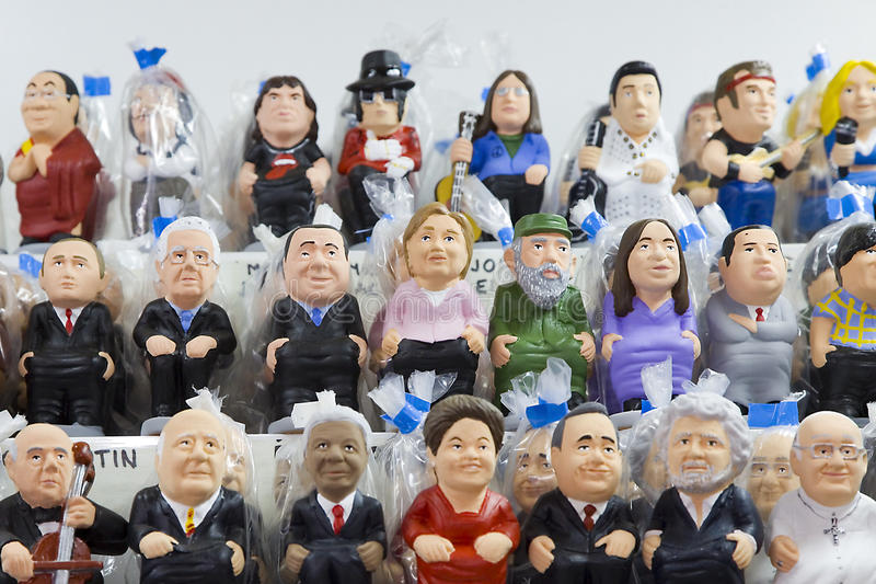 Caganers in Santa Llucia fair, Barcelona. BARCELONA - DECEMBER 1: Caganers, originally a character in Catalan mythology, now portraying famous celebrities or royalty free stock photos