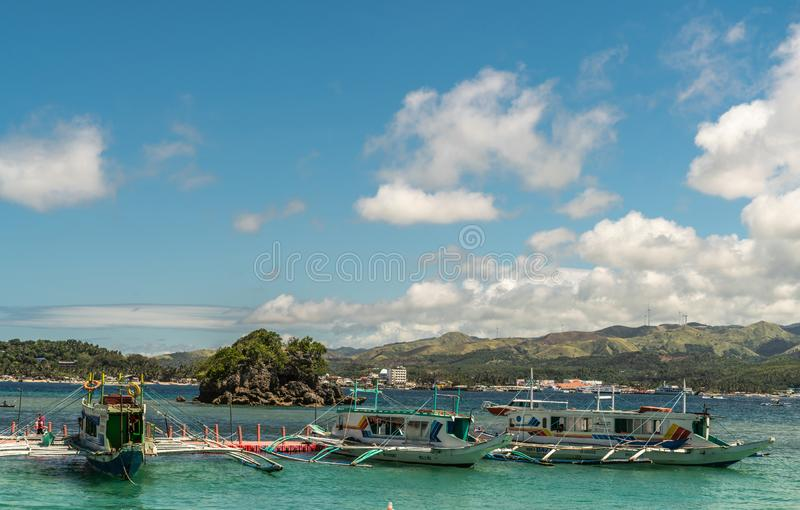 Cagban Jetty Port with three outrigger vessels in Manoc-Manoc, Boracay Island, Philippines royalty free stock photos