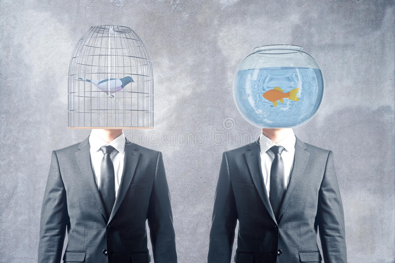 Cage and fishbowl heads stock photography