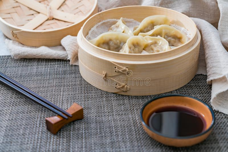 A cage of steamed dumplings, a traditional Chinese delicacy royalty free stock images