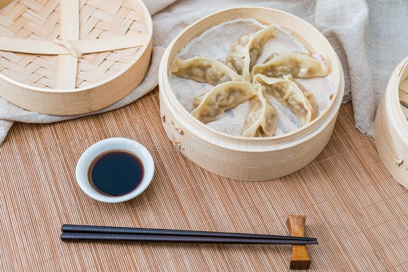 A cage of steamed dumplings, a traditional Chinese delicacy stock image