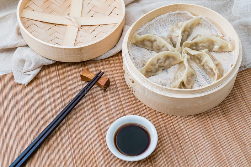 A cage of steamed dumplings, a traditional Chinese delicacy stock photography