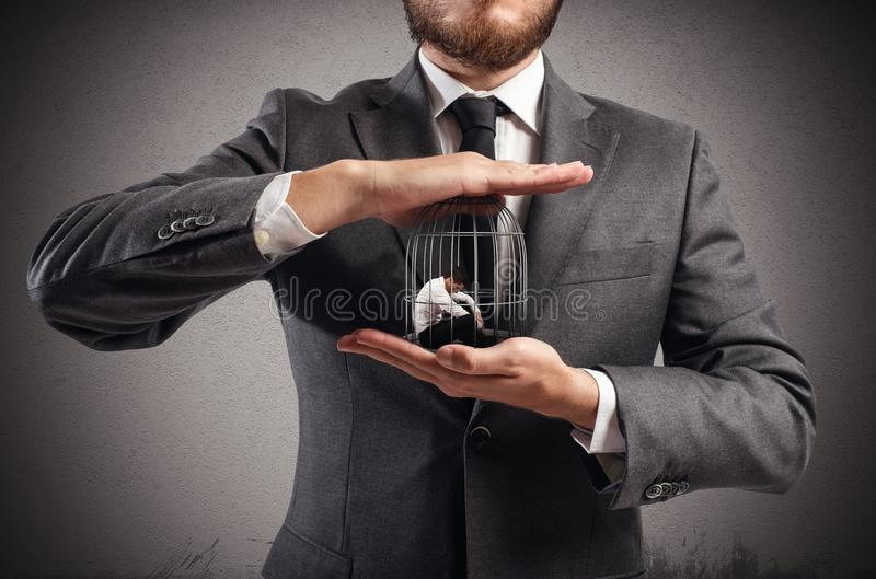 Caged businessman royalty free stock image
