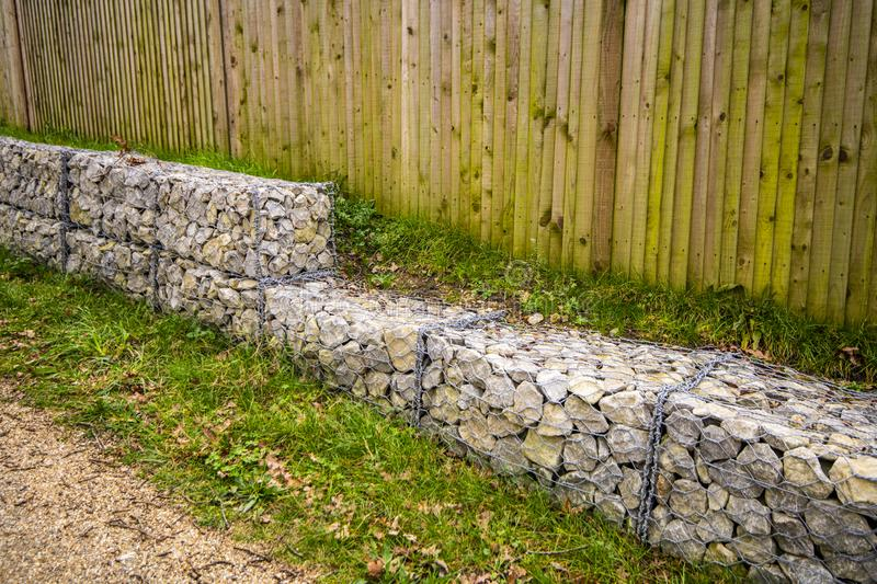 Caged stone block wall for construction projects. Stone blocks held in wire cages for use in building and construction industries - especially in countryside royalty free stock photos