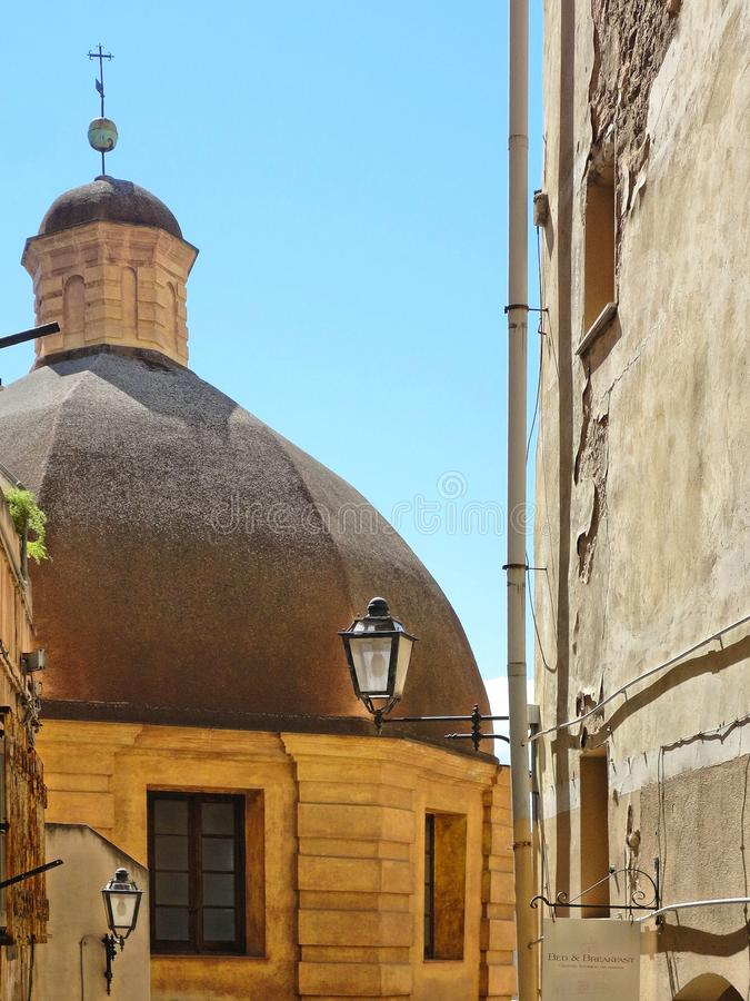 Cagliari colorful corner with church dome and city lamp in bright summer day, Sardinia Italy stock photography