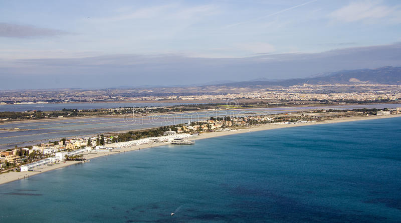 Cagliari: Panorama of Poetto beach- Sardinia. Overview of the beach poetto from the hill of the Sella del Diavolo, in the background one can see the salt marshes stock photos