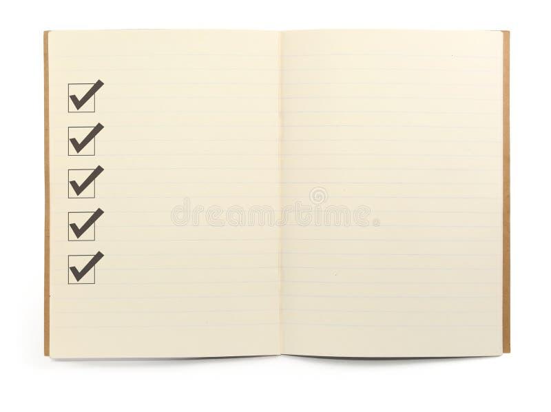 Cahier avec la liste de contrôle photographie stock libre de droits