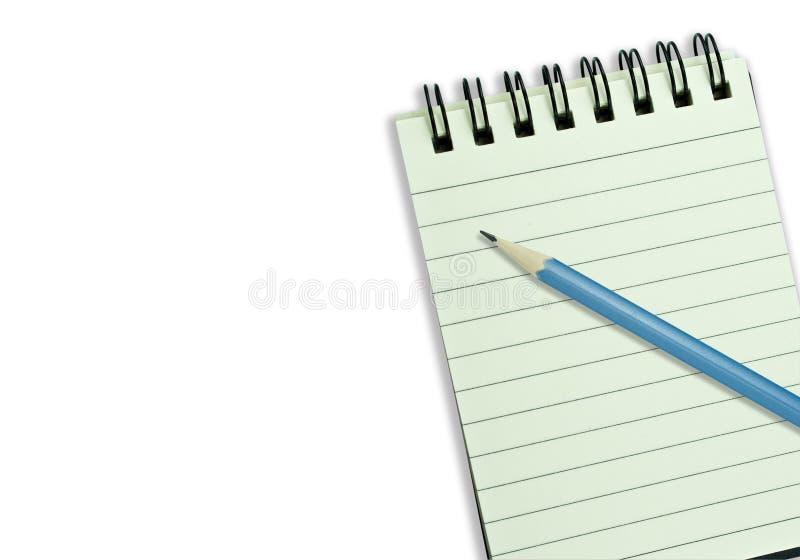 Cahier d'isolement de cahier avec le papier et le bleu rayés photo stock