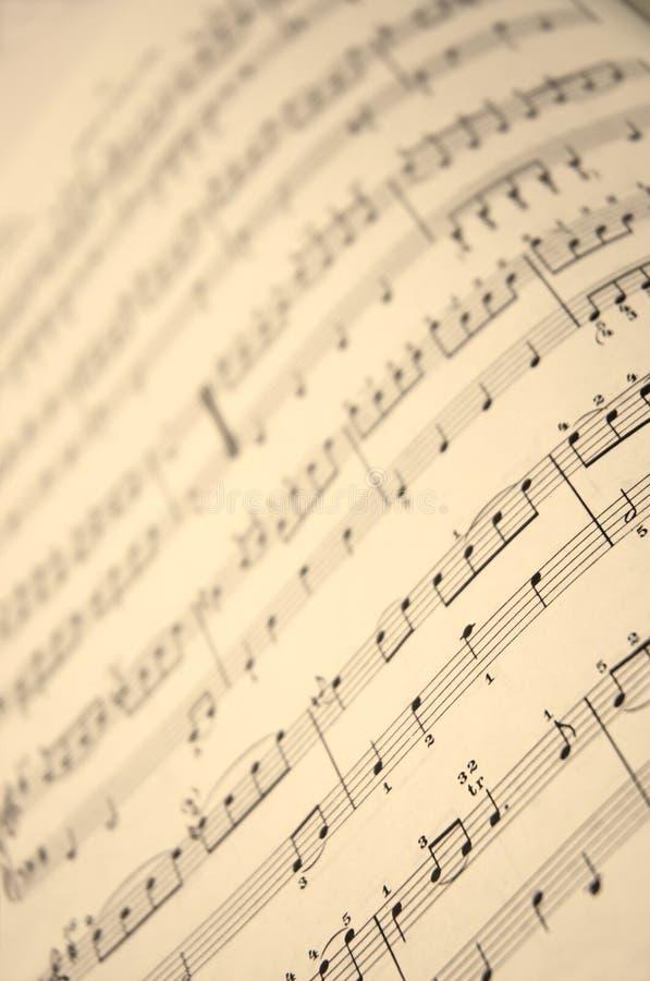 Cahier de musique dans la fin vers le haut photo libre de droits