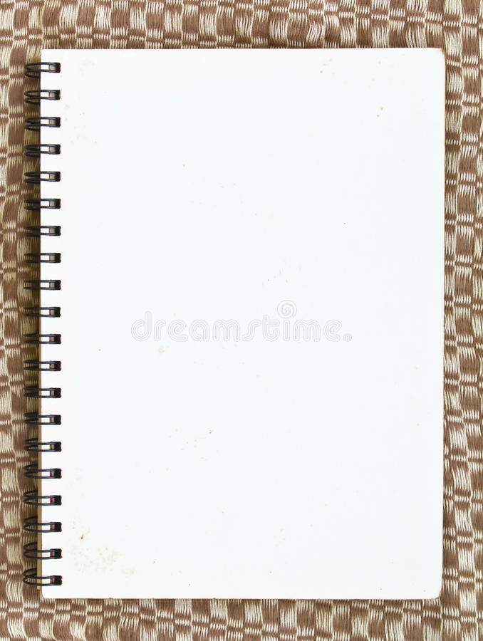 Cahier sur le tissu photographie stock