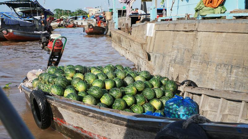Cai Rang Floating Market Mekong Delta in Can Tho Vietnam. River Can Tho, working on boating, agricultural business on the boat, a boat full of watermelon stock images