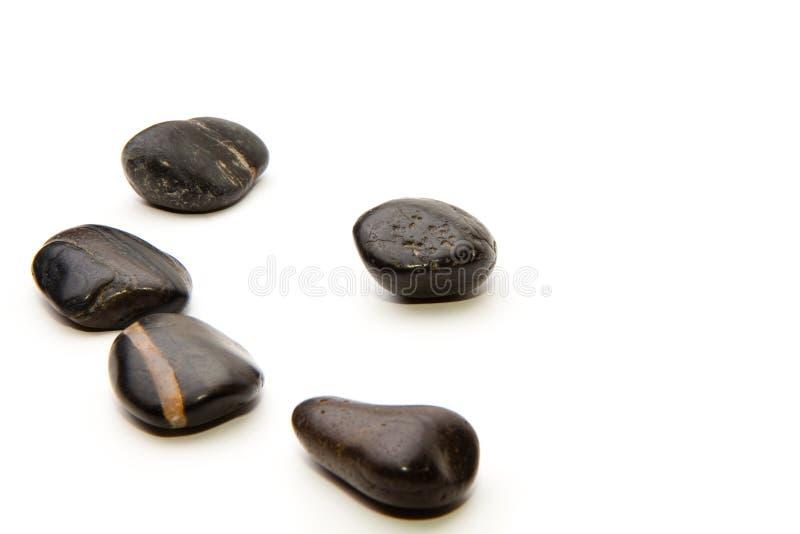 Cailloux noirs brillants photos stock