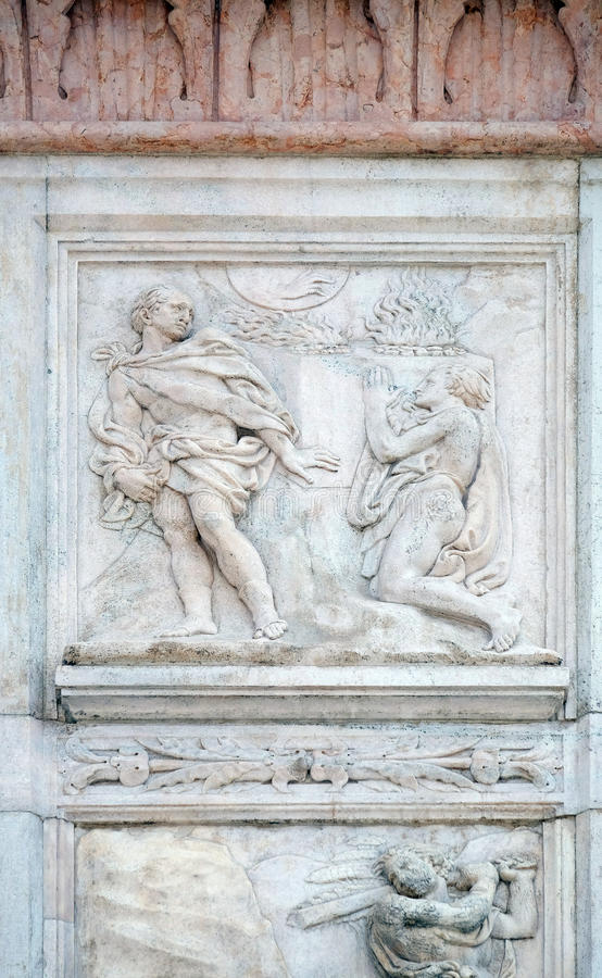 Cain and Abel sacrifices. Genesis relief on portal of Saint Petronius Basilica in Bologna, Italy royalty free stock photos
