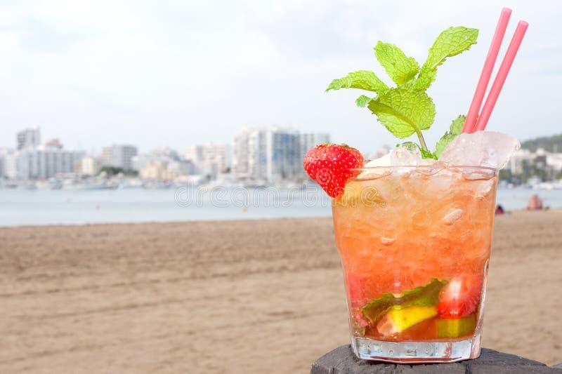 Caipirinha cocktail on beach royalty free stock photo