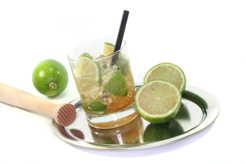 Caipirinha with fresh lime stock images