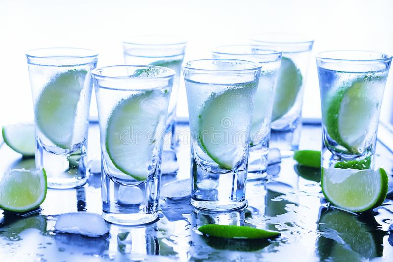 Caipirinha. Tequila, Gin tonic with lime wedges royalty free stock photography