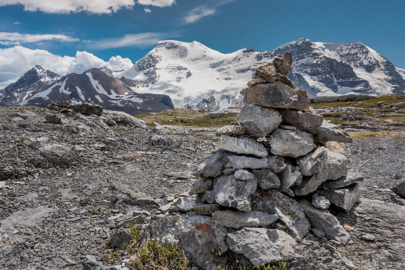 Cairn atop Wilcox Pass. With View of Snowy Mountains royalty free stock photography