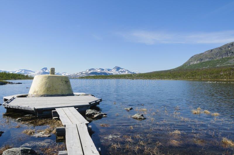 Cairn de Trois-pays en Laponie images stock