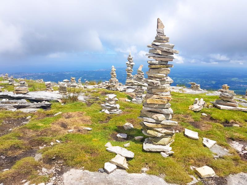 Cairn (Inukshuk rocks) at the top of La Rhune mountain in the Atlantic Pyrenees. Border between Spain and France stock photo
