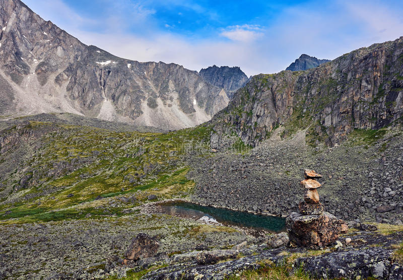 Cairn in mountain tundra. Cairn indicating the hiking trails in the mountain tundra. Eastern Siberia. Eastern Sayan stock images