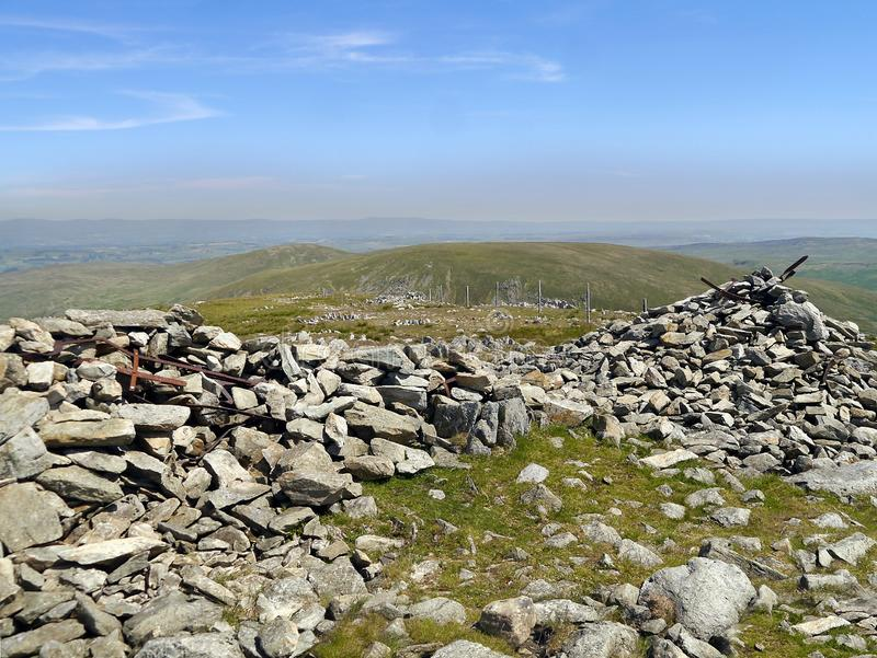 Cairn and shelter remains on Harter Fell, Lake District royalty free stock photo