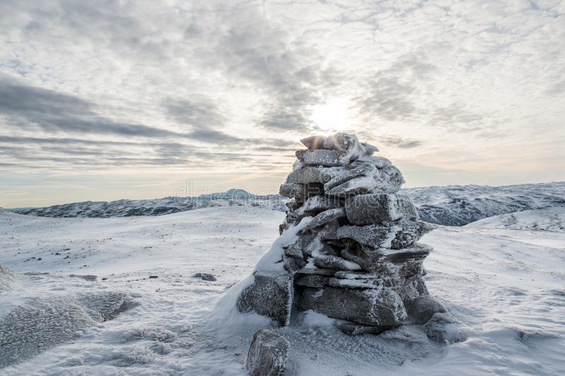 Cairn in Tinn. Picture of a Cairn on top og Gaværn, A mountain i Tinn, Norway. In the background you can see Gaustatoppen. Gaustatoppen is known for an amazing stock images