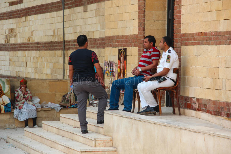 Cairo, EGYPT - Apr 22, 2015, Police officers and security guards guard the entrance to a Christian Church, on Apr 22 2015 in Cairo stock photos