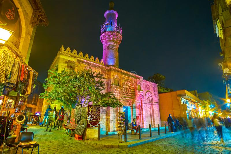 The beautiful illuminated medieval mosque in Cairo, Egypt. CAIRO, EGYPT - DECEMBER 20, 2017: The Al Aqmar mosque with beautiful night illumination located on the royalty free stock image