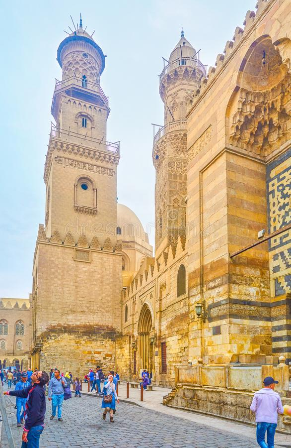 The medieval Cairo, Egypt. CAIRO, EGYPT - DECEMBER 20, 2017: The beautiful carved minarets of Qalawun complex are the fine example of architecture of medieval stock images