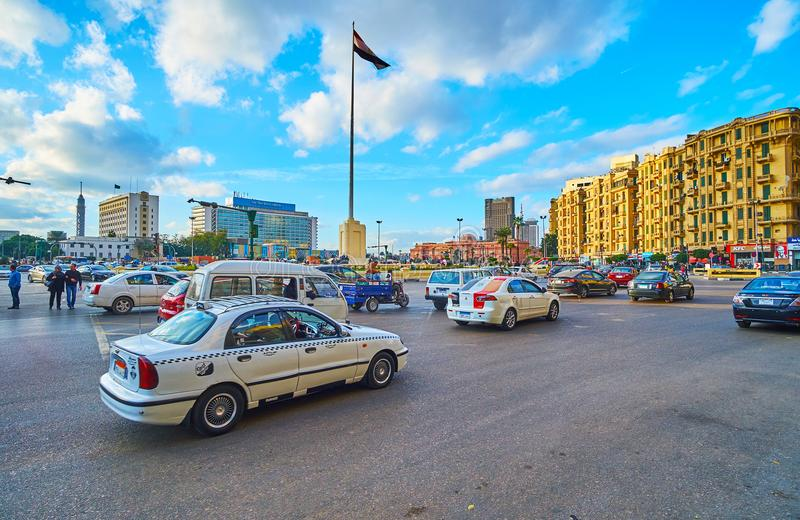 Traffic on Midan Tahrir, Cairo, Egypt. CAIRO, EGYPT - DECEMBER 24, 2017: The heavy traffic on Midan Tahrir square, one of the central locations of Downtown, on royalty free stock photos