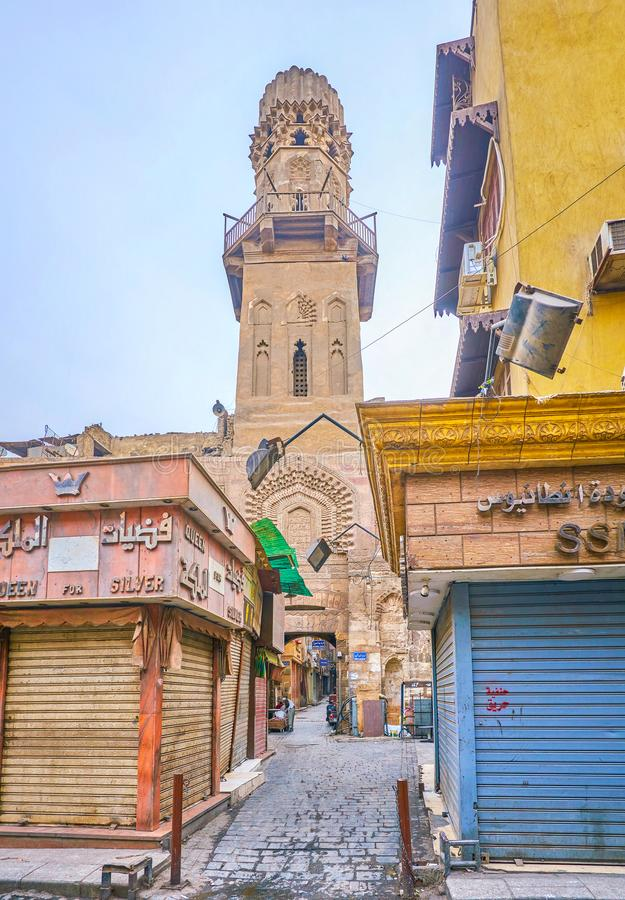 The minaret of medieval madrasa in Islamic Cairo, Egypt. CAIRO, EGYPT - DECEMBER 23, 2017: The high minaret of Madrasa of al-Salih Najm al-Din Ayyub is a pearl stock photos