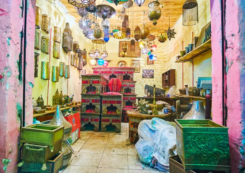 CAIRO, EGYPT - DECEMBER 21, 2017: Interior of souvenir shop in Souk Khan El Khalili with handmade Arabic lights of carved metal stock photo