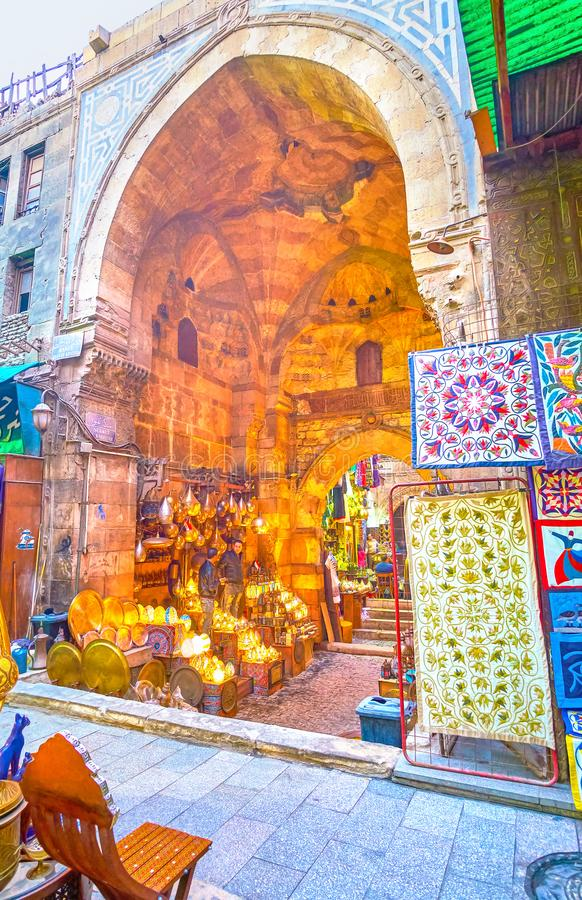 The medieval gates with lighting shop, Cairo, Egypt. CAIRO, EGYPT - DECEMBER 20, 2017: The medieval Bab al-Ghuri gates with colorful dome and inner lighting shop stock photography
