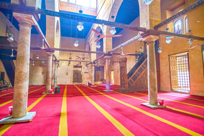 The medieval mosque in Cairo, Egypt. CAIRO, EGYPT - DECEMBER 20, 2017: The modest interior of small medieval mosque in Sabil Kuttab of Shaykh Ali Al-Mutahhari royalty free stock photo