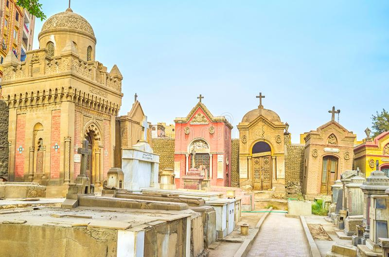 The medieval christian cemetery in Cairo, Egypt. CAIRO, EGYPT - DECEMBER 23, 2017: The old decrepit crypts and tombs in medieval cemetery in Coptic district, on royalty free stock images