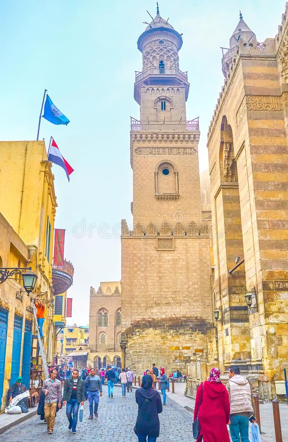 The medieval architecture of old Cairo, Egypt. CAIRO, EGYPT - DECEMBER 20, 2017: The stately historical Qalawun Complex in Al-Muizz street attracts tourists and royalty free stock image