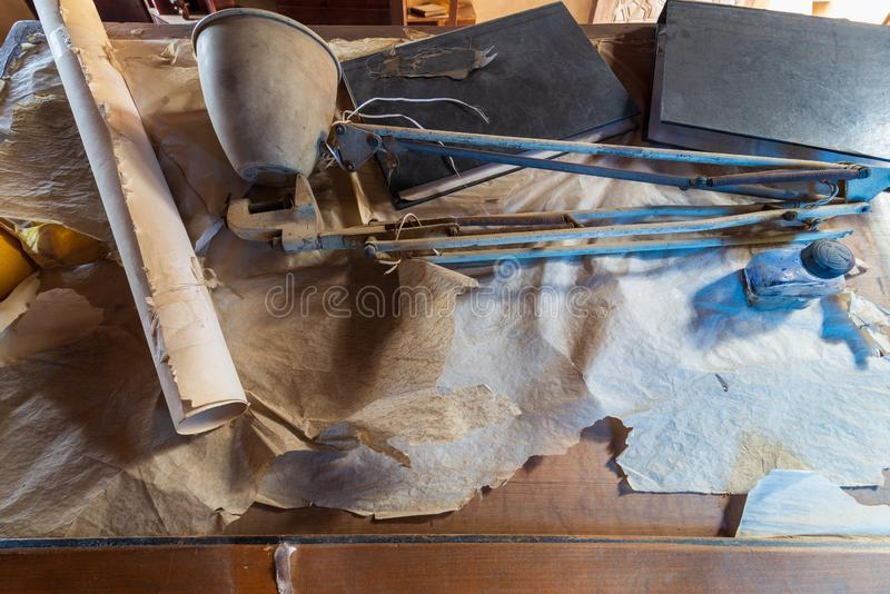 Drawing board of late architect Hassan Fathy at his architecture studio, Ottoman era House of Egyptian Architecture. Cairo, Egypt - January 8 2019: Drawing board royalty free stock photos
