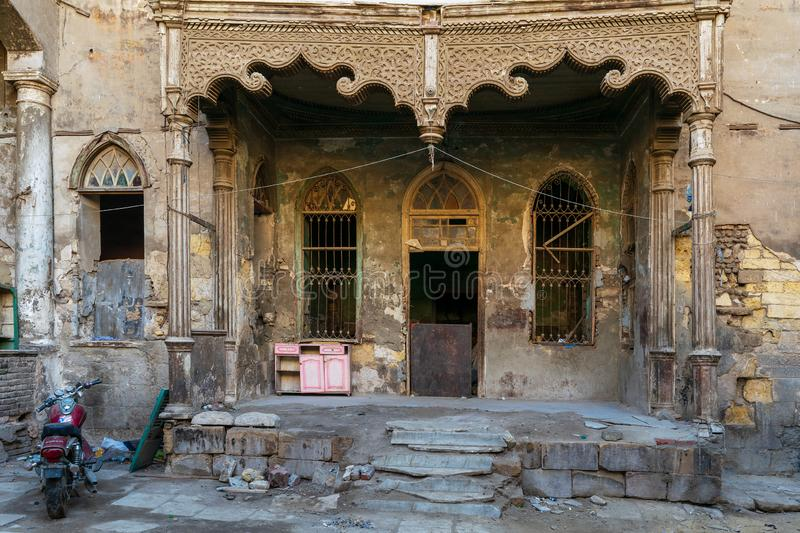 Facade of Bayt Madkour Pasha historic abandoned house, Souq Al Selah Street, Old Cairo, Egypt. Cairo, Egypt- January 16 2016: Facade of Bayt Madkour Pasha stock photos