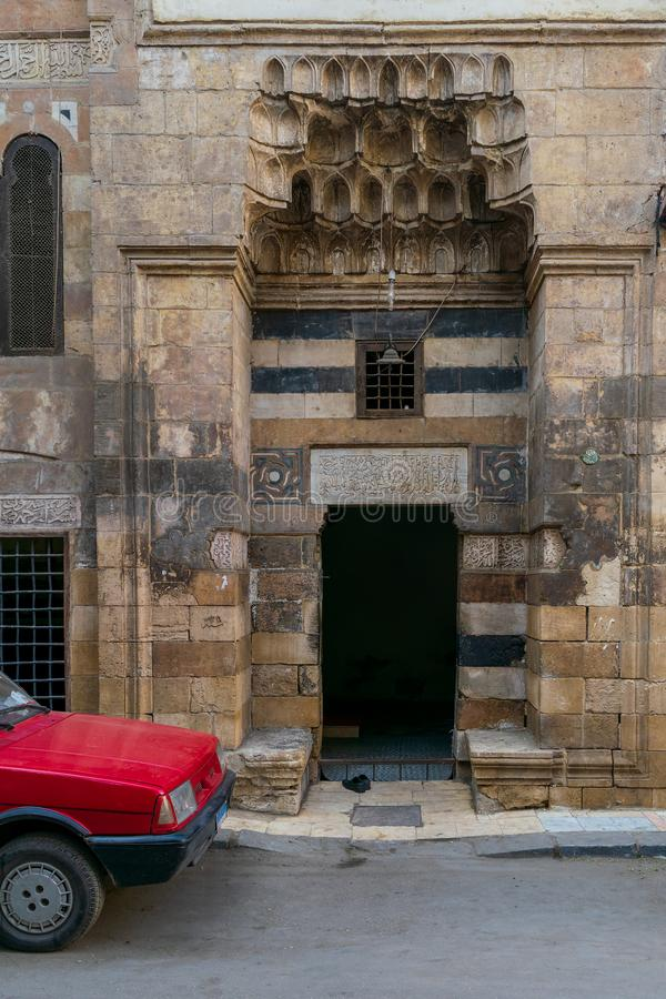 Mosque entrance at Souq El Selah Street, Darb El Ahmar district, Cairo, Egypt. Cairo, Egypt- January 16 2016: Mosque entrance at Souq El Selah Street, Darb El royalty free stock photography