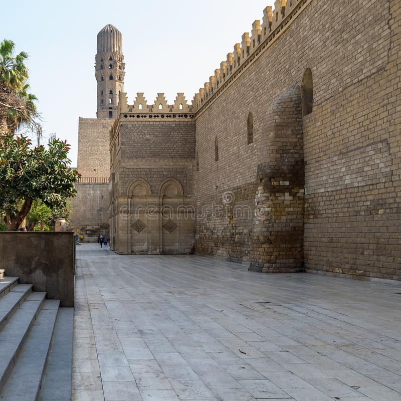 Outer wall and minaret of public historic Al Hakim Mosque - Enlightened Mosque - Moez Street, Cairo. Cairo, Egypt- March 21 2015: Outer wall of public historic royalty free stock image