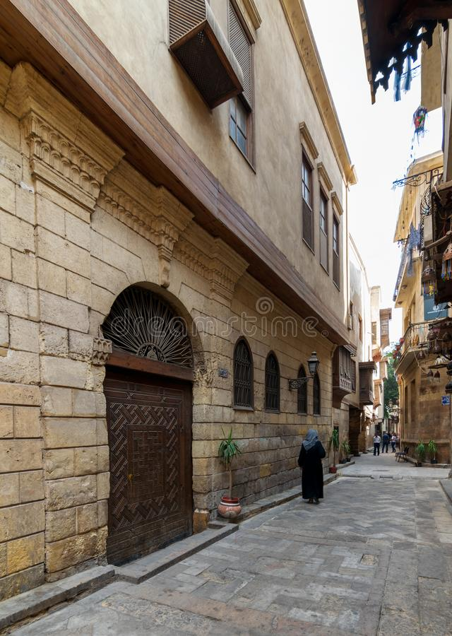 Darb Asfour Lane with facade of Bayt Al-Suhaymi old historic house, Medieval Cairo, Egypt. Cairo, Egypt- November 19 2016: Darb Asfour Lane with facade of Bayt stock photos