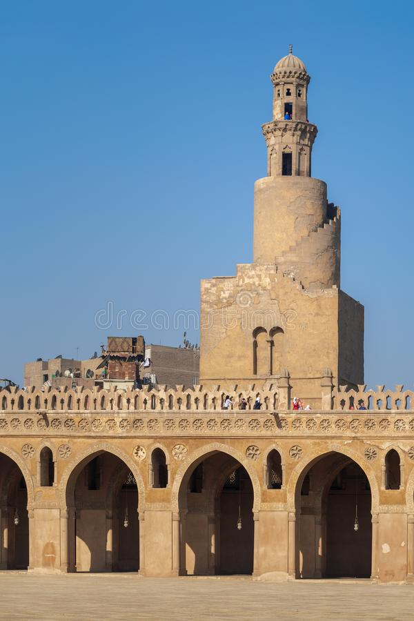 Minaret of Ibn Tulun Mosque, Medieval Cairo, Egypt. Cairo, Egypt - November 27, 2015: Minaret of Ibn Tulun Mosque, Medieval Cairo, Egypt stock image