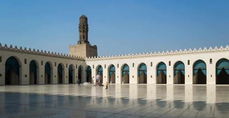 Courtyard of public historic Al Hakim Mosque known as The Enlightened Mosque with minaret, Cairo. Cairo, Egypt- September 28 2012: Courtyard of public historic stock image